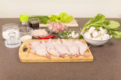 Quails a whole bird and products for stuffing Stock Photo