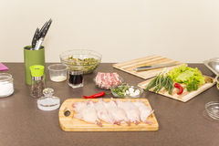Quails a whole bird and products for stuffing Royalty Free Stock Photo