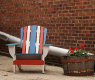 Quaint Americana Chair in alley with brick building Stock Photography