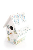 Quaint birdhouse. Isolated on white royalty free stock photography