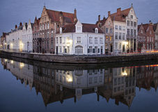 Quaint buildings on canal. Quaint European buildings along a quiet canal at daybreak.  Bruges, Belgium Royalty Free Stock Image