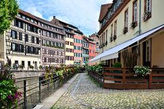 Quaint, buildings along a canal, Strasbourg, Alsace, France royalty free stock photo
