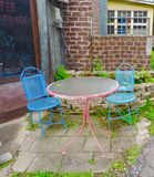 Quaint colorful table. Patio table outside coffee Royalty Free Stock Photo
