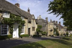 Quaint Cotswold cottages, Burford, Oxfordshire, UK. Quaint old Cotswold cottages line The Hill in Burford, The Cotswolds, Oxfordshire, UK Royalty Free Stock Photography