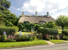 Quaint countryside cottage in England. Quaint countryside cottage and pretty summer garden Stock Images