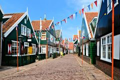 Quaint Dutch village. Flag filled street in the historic fishing village of Marken, Netherlands Stock Photo