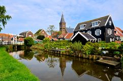 Quaint Dutch village. Picturesque Dutch fishing village of Marken with canal and reflections Royalty Free Stock Images