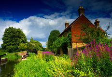 Quaint English Cottage By The River Wey. Walsham Weir, Surrey. Stock Images