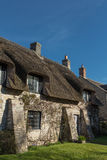 Quaint English thatched cottage. Quaint English cottage with traditional thatched roof Royalty Free Stock Photography