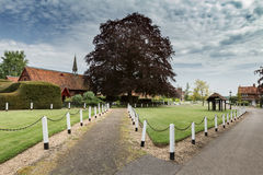 A quaint English village with church and well Royalty Free Stock Images
