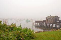 Quaint fishing wharf in fog Royalty Free Stock Photos