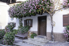 A Quaint flower Decorated House and Doorway in an Alpine Village Stock Photography