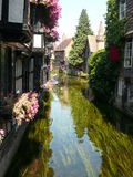 Quaint houses along stream Stock Photo