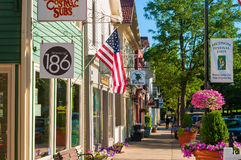 Quaint Hudson. HUDSON, OH - JUNE 14, 2014: Quaint shops and businesses give Hudson's Main Street a charming and inviting appearance that attracts visitors from Stock Images