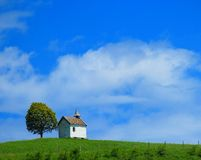 Quaint little chapel on lush hilltop Royalty Free Stock Photography