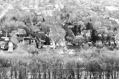 Quaint mature community neighbourhood nestled among winter trees Stock Photography