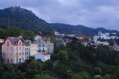Quaint Mountainside Village at Dusk Stock Photography