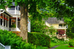 Quaint old homes. Line a tree-shaded street in an older neighborhood Stock Photo
