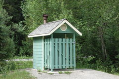 A quaint outhouse at waterton park in alberta Stock Photography