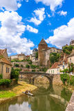 Quaint river through the medieval town of Semur en Auxois Stock Photos
