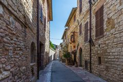 Quaint street in Assisi. Umbria, Italy stock photos