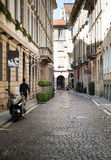Quaint Street in Milan. Milan, Italy - September 5th, 2015: a man walking down a quaint street in central Milan Royalty Free Stock Photos