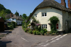 Quaint thatched cottage. In a Devon village Royalty Free Stock Photo