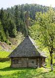 Quaint timber cabin with wooden shingles Stock Photos
