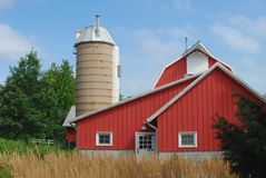 A quaint traditional farmstead. Looking like Old McDonald's perfect red barn and silo Royalty Free Stock Photos