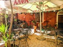 Quaint yard of a coffee shop in Corfu. In Agias sophias street Royalty Free Stock Photography