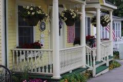 Quaint yellow cottage Mackinac Island stock photography