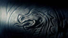 Qualcuno esamina Dragon Carving With Torch stock footage