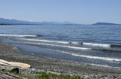 Qualicum Beach, Vancouver Island. View over the Georgia Strait from Qualicum Beach on a sunny day with blue sky, Vancouver Island British Columbia Canada Royalty Free Stock Photos