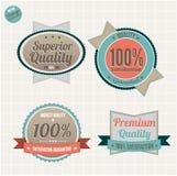 A qualidade e a satisfação garantem emblemas Fotos de Stock Royalty Free