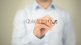 Qualification , Man writing on transparent screen. High quality Royalty Free Stock Photo