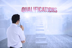 Qualifications against city scene in a room Royalty Free Stock Photo