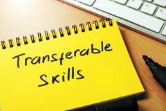 Qualifications transmissibles écrites sur une page photos libres de droits