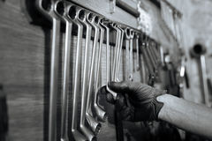 Qualified able specialist choosing a wrench Royalty Free Stock Photos