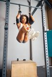 Qualified athletic woman doing a gymnastic exercise