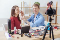 Qualified beauty bloggers demonstrating new amazing facial powder Royalty Free Stock Image