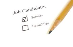 Qualified candidate. Job candidate check box and a pencil on white stock photography