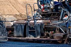Qualified engineer operating asphalt paver machine Stock Photography