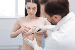 Qualified plastic surgeon putting guiding marks before procedure Royalty Free Stock Images