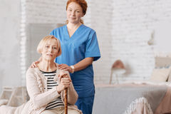 Qualified private nurse assisting elderly patient Royalty Free Stock Image