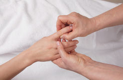 Qualified therapist  doing  hand massage Stock Photography