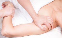 A qualified therapist doing a pressure point massage Royalty Free Stock Images
