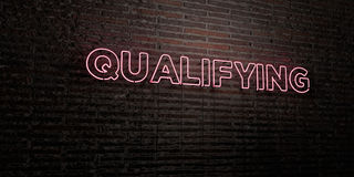 QUALIFYING -Realistic Neon Sign on Brick Wall background - 3D rendered royalty free stock image. Can be used for online banner ads and direct mailers Royalty Free Stock Image