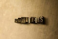 QUALITÄTEN - Nahaufnahme des grungy Weinlese gesetzten Wortes auf Metallhintergrund Stockfotos