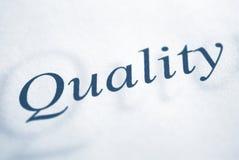 Qualitätswort auf einem Weißbuch Lizenzfreies Stockbild