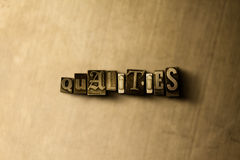 QUALITIES - close-up of grungy vintage typeset word on metal backdrop. Royalty free stock illustration.  Can be used for online banner ads and direct mail Stock Photos